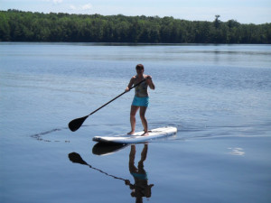 Paddle boarding at Virgin Timber Resort.