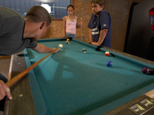 Game room at Acra Manor Resort.