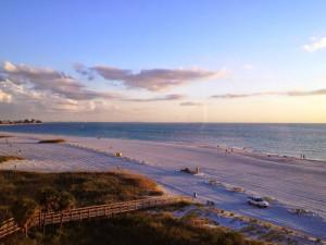The beach at Sunset Vistas Beachfront Suites.