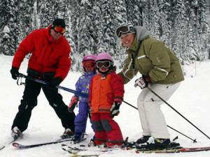 Family skiing at Douglas Fir Resort & Chalets.