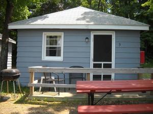 Cabin exterior at Cozy Cove Resort.