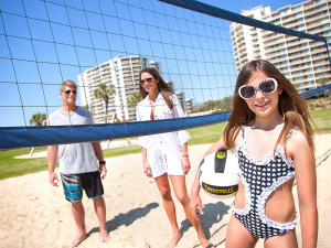 Family on beach at Ocean Creek Resort.