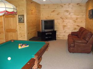 Billiards table living room at Black Bear Cabin Rentals.
