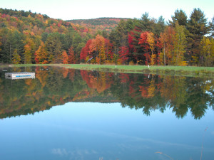 Fall colors on the private swimming pond at Common Ground Center.