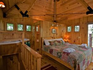 Cabin bedroom at Ludlow's Island Resort.