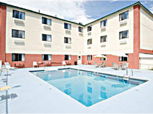 Outdoor pool at Comfort Inn Lakes Region.