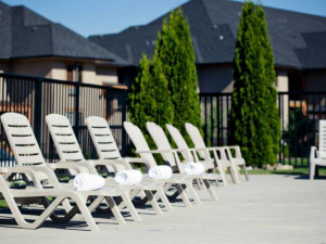 Pool chairs at Bighorn Meadows Resort.