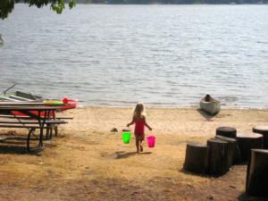 Playing at the beach at Oak Cove Resort.
