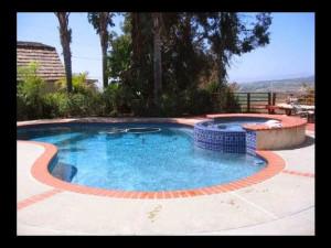 Outdoor pool at Vista Bed & Breakfast.
