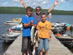 Family fishing at Trout Lake Resort.
