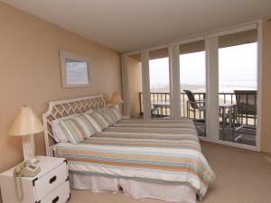 Condo bedroom at The Dunes Condominiums.