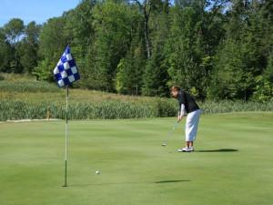 Golfing at Drummond Island Resort.