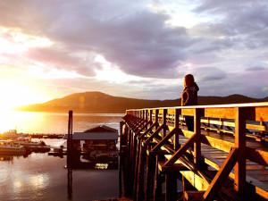 Sunrise on dock at Salmon Falls Resort.