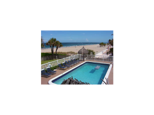 Outdoor pool and beach at Seaside Beach Club.