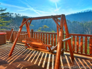 Cabin bench swing at American Patriot Getaways, LLC.