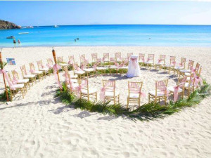 Beach wedding at Island Properties Luxury Rentals.