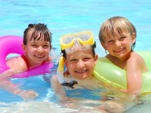 Swimming in the pool at Casiola Vacation Homes.