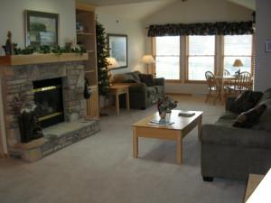 Living room fireplace at Birchwood Lodge.