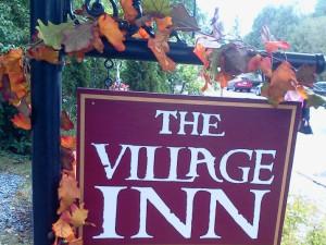 The Village Inn sign.