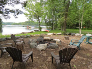 Lakeside Bonfire pit on the shore of Eagle Lake at All-Season Cottage Rentals.