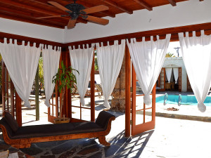 Relax by the pool at Korakia Pensione.