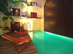 Outdoor pool at Hotel Las Palapas.