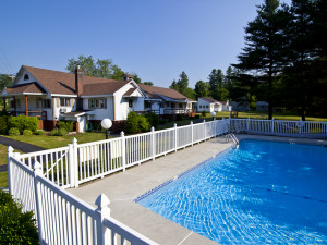 Outdoor pool at Riverbank Motel & Cabins.