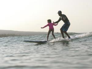Surfing at Lumeria Maui.
