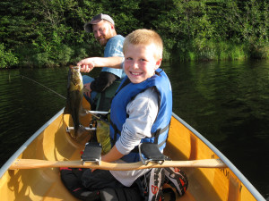 Family lake fishing at Clearwater Historic Lodge.