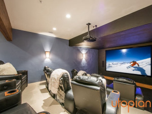 Rental movie room at Utopian Luxury Vacation Homes.