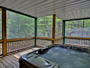 Deck jacuzzi at Georgia Mountain Cabin Rentals.