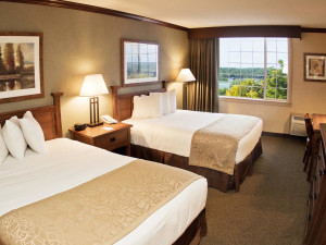 Double queen beds, and bathroom with shower. Double Queen available with tub. Rooms feature lakeside views, flat-screen television and wireless internet access.
