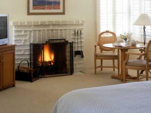 Guest room with fireplace at Smoke Tree Ranch.