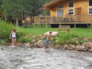 Kids playing in the river at Riverview Pines.