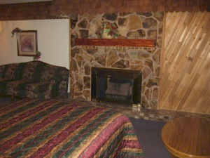 Fireplace guest room at Cedar Wood Inn.