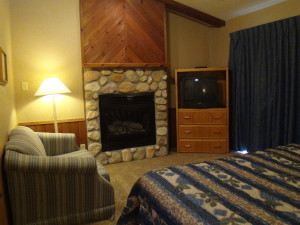 Fireplace bedroom at Kavanaugh's Sylvan Lake Resort.