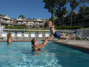 Family playing in the pool at Westwood Shores Waterfront Resort.