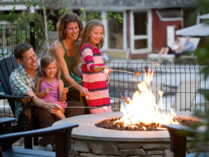 Family by bonfire at The Green Mountain Inn.
