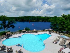 Outdoor swimming pool overlooking Lake Teedyuskung at Woodloch Resort