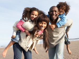 Family on the beach at The Oceanfront Inn.