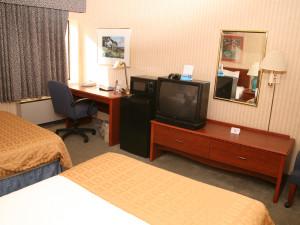 Guest room at Baymont InnSuites Detroit Roseville.