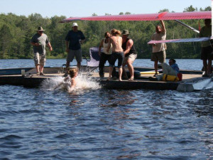 Jumping in lake at Crooked Lake Wilderness Lodge.
