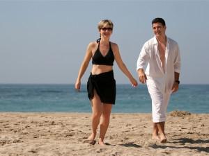 Couple on the beach at Sanctuary Realty At Sandbridge.