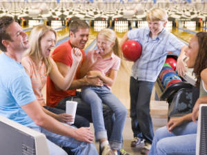 Family bowling at Eaglewood Resort & Spa.