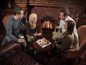 Couples by fireplace at Prince of Wales Hotel .