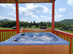 Deck jacuzzi at Fireside Chalets & Cabin Rentals.