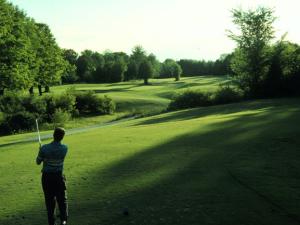 Playing golf at The Briars.
