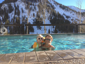 Family swimming at Alta's Rustler Lodge.