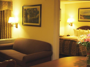 Guest room at Greenwood Suites Anaheim Resort.