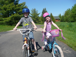 Kids biking at Woodside Cottages of Bayfield.